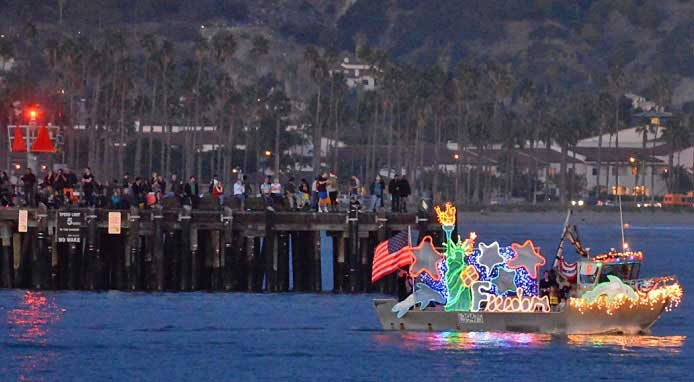 The Parade of Lights is in December in Santa Barbara California. The Perserverance is decortated with a Statue of Liberty and lights.