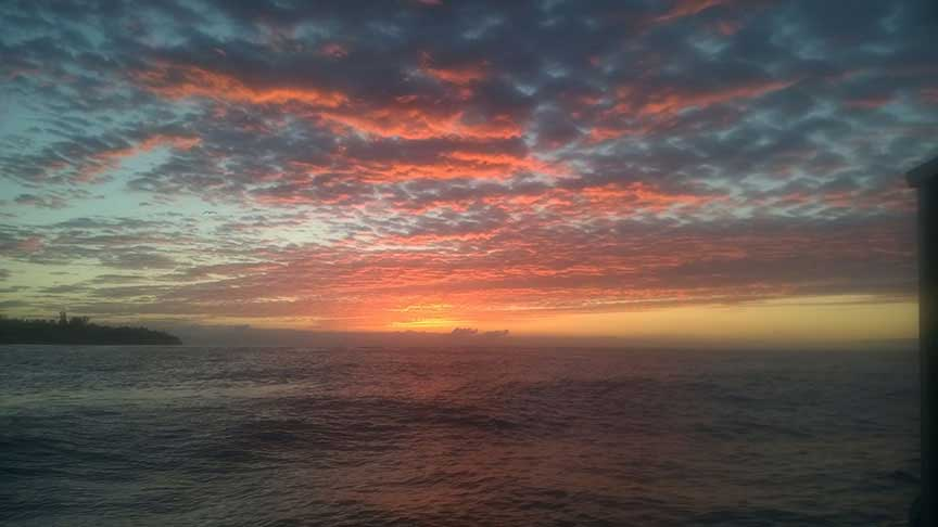 A beautiful sunrise seen from the boat named the Perserverance while heading out to the Santa Barabara Mariculture Farm